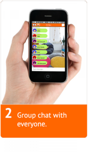 A hand holding a mobile showing a chat venue with multiple people talking in it.